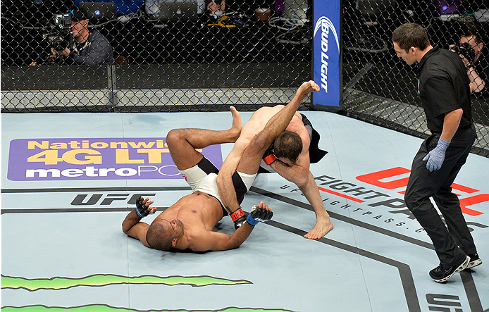 LAS VEGAS, NEVADA - DECEMBER 10:  (Top) Omari Akhmedov punches Sergio Moraes in their welterweight bout during the UFC Fight Night event at The Chelsea at the Cosmopolitan of Las Vegas on December 10, 2015 in Las Vegas, Nevada.  (Photo by Brandon Magnus/Z