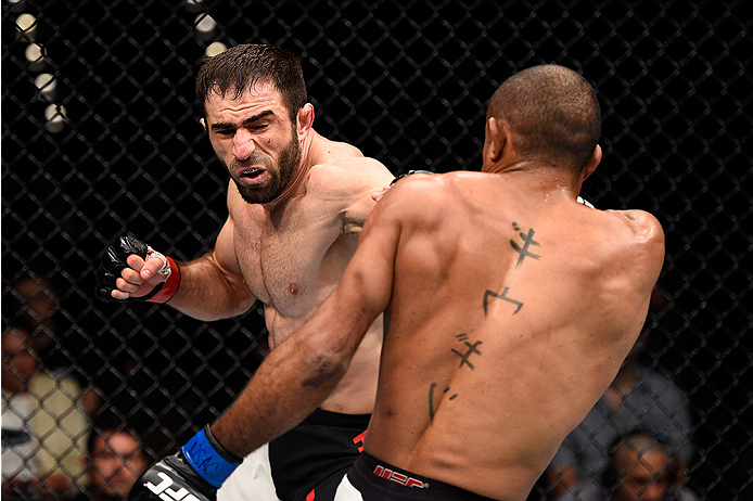 LAS VEGAS, NEVADA - DECEMBER 10:  (L) Omari Akhmedov punches Sergio Moraes in their welterweight bout during the UFC Fight Night event at The Chelsea at the Cosmopolitan of Las Vegas on December 10, 2015 in Las Vegas, Nevada.  (Photo by Jeff Bottari/Zuffa