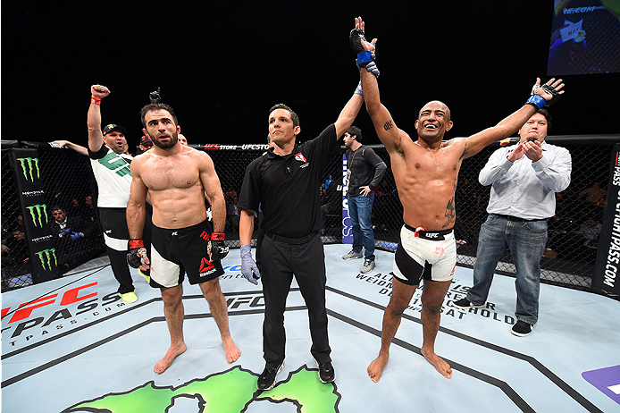 LAS VEGAS, NEVADA - DECEMBER 10:  (R) Sergio Moraes celebrates his win over Omari Akhmedov in their welterweight bout during the UFC Fight Night event at The Chelsea at the Cosmopolitan of Las Vegas on December 10, 2015 in Las Vegas, Nevada.  (Photo by Je