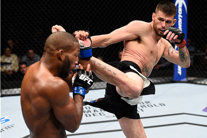LAS VEGAS, NEVADA - DECEMBER 10:  (R) Tim Means kicks John Howard in their welterweight bout during the UFC Fight Night event at The Chelsea at the Cosmopolitan of Las Vegas on December 10, 2015 in Las Vegas, Nevada.  (Photo by Jeff Bottari/Zuffa LLC/Zuff