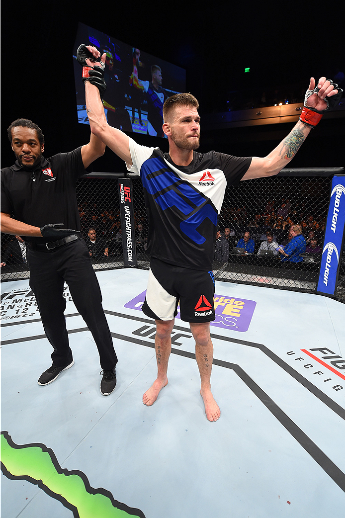 LAS VEGAS, NEVADA - DECEMBER 10:  Tim Means celebrates his win over John Howard in their welterweight bout during the UFC Fight Night event at The Chelsea at the Cosmopolitan of Las Vegas on December 10, 2015 in Las Vegas, Nevada.  (Photo by Jeff Bottari/