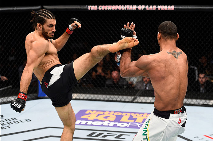 LAS VEGAS, NEVADA - DECEMBER 10:  (L) Elias Theodorou kicks Thiago Santos in their middleweight bout during the UFC Fight Night event at The Chelsea at the Cosmopolitan of Las Vegas on December 10, 2015 in Las Vegas, Nevada.  (Photo by Jeff Bottari/Zuffa