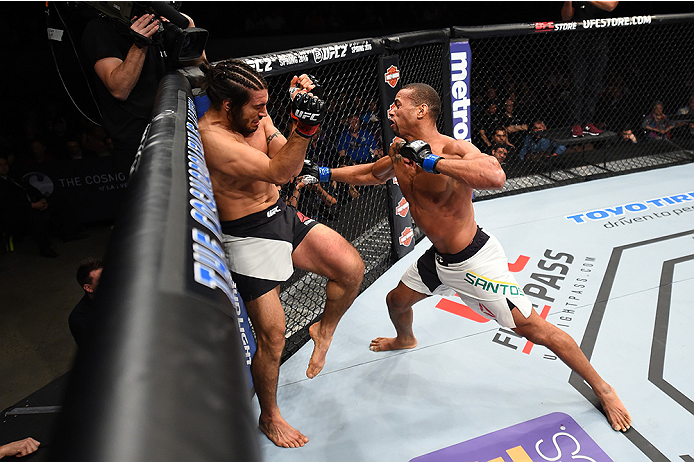 LAS VEGAS, NEVADA - DECEMBER 10:  (R) Thiago Santos punches Elias Theodorou in their middleweight bout during the UFC Fight Night event at The Chelsea at the Cosmopolitan of Las Vegas on December 10, 2015 in Las Vegas, Nevada.  (Photo by Jeff Bottari/Zuff