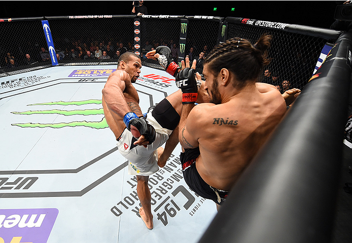 LAS VEGAS, NEVADA - DECEMBER 10:  (L) Thiago Santos kicks Elias Theodorou in their middleweight bout during the UFC Fight Night event at The Chelsea at the Cosmopolitan of Las Vegas on December 10, 2015 in Las Vegas, Nevada.  (Photo by Jeff Bottari/Zuffa