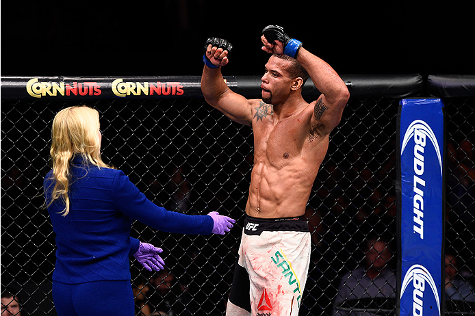 LAS VEGAS, NEVADA - DECEMBER 10:  Thiago Santos celebrates after his win over Elias Theodorou in their middleweight bout during the UFC Fight Night event at The Chelsea at the Cosmopolitan of Las Vegas on December 10, 2015 in Las Vegas, Nevada.  (Photo by