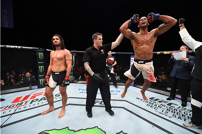 LAS VEGAS, NEVADA - DECEMBER 10:  (R) Thiago Santos celebrates his win over Elias Theodorou in their middleweight bout during the UFC Fight Night event at The Chelsea at the Cosmopolitan of Las Vegas on December 10, 2015 in Las Vegas, Nevada.  (Photo by J