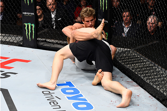 LAS VEGAS, NEVADA - DECEMBER 10:  (Top) Sage Northcutt grapples with Cody Pfister in their lightweight bout during the UFC Fight Night event at The Chelsea at the Cosmopolitan of Las Vegas on December 10, 2015 in Las Vegas, Nevada.  (Photo by Jeff Bottari