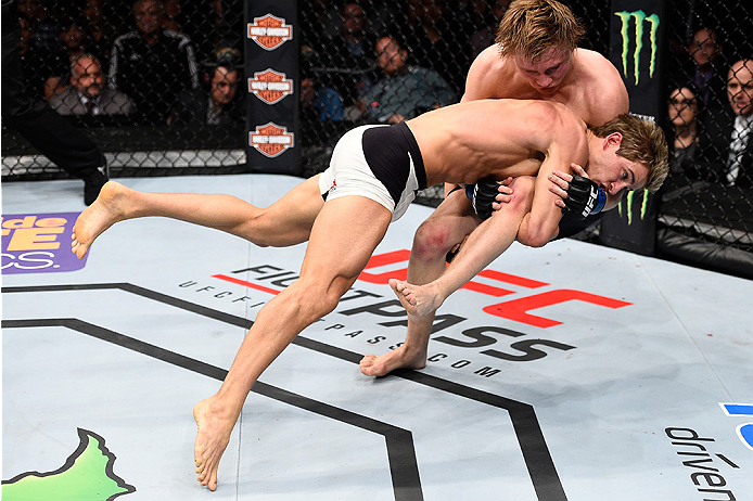 LAS VEGAS, NEVADA - DECEMBER 10:  (Bottom) Sage Northcutt takes down Cody Pfister in their lightweight bout during the UFC Fight Night event at The Chelsea at the Cosmopolitan of Las Vegas on December 10, 2015 in Las Vegas, Nevada.  (Photo by Jeff Bottari