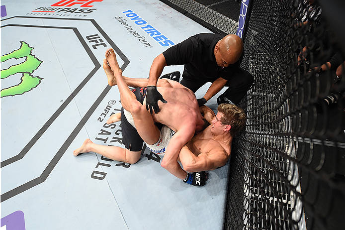 LAS VEGAS, NEVADA - DECEMBER 10:  (Bottom) Sage Northcutt wins by submission over Cody Pfister in their lightweight bout during the UFC Fight Night event at The Chelsea at the Cosmopolitan of Las Vegas on December 10, 2015 in Las Vegas, Nevada.  (Photo by