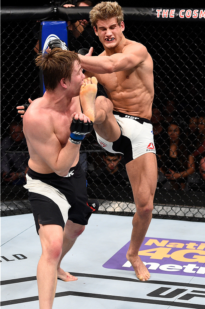 LAS VEGAS, NEVADA - DECEMBER 10:  (R) Sage Northcutt kicks Cody Pfister in their lightweight bout during the UFC Fight Night event at The Chelsea at the Cosmopolitan of Las Vegas on December 10, 2015 in Las Vegas, Nevada.  (Photo by Jeff Bottari/Zuffa LLC