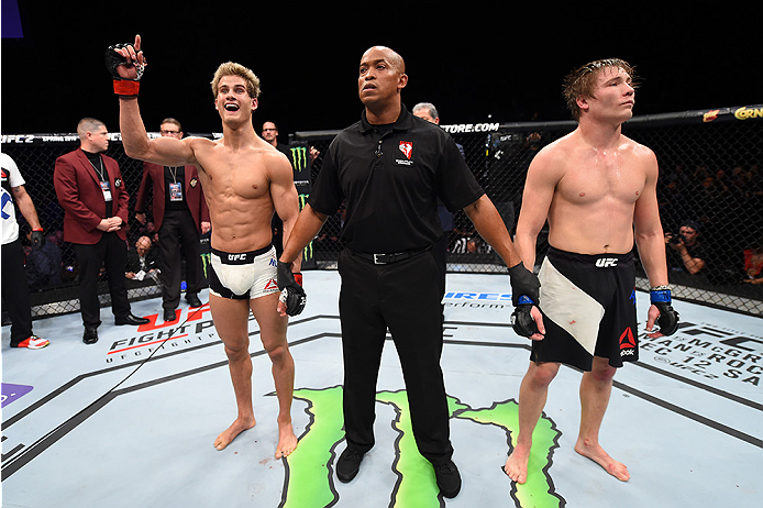 LAS VEGAS, NEVADA - DECEMBER 10:  (L) Sage Northcutt celebrates his win over Cody Pfister in their lightweight bout during the UFC Fight Night event at The Chelsea at the Cosmopolitan of Las Vegas on December 10, 2015 in Las Vegas, Nevada.  (Photo by Jeff
