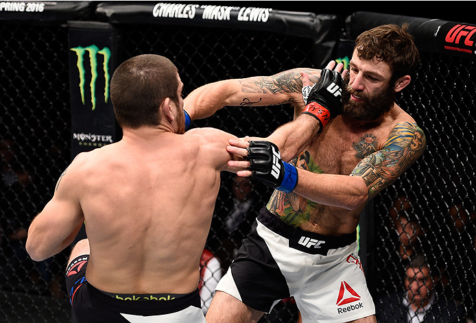 LAS VEGAS, NEVADA - DECEMBER 10:  (L) Jim Miller exchanges punches with Michael Chiesa in their lightweight bout during the UFC Fight Night event at The Chelsea at the Cosmopolitan of Las Vegas on December 10, 2015 in Las Vegas, Nevada.  (Photo by Jeff Bo