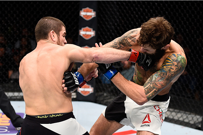 LAS VEGAS, NEVADA - DECEMBER 10:  (L) Jim Miller punches Michael Chiesa in their lightweight bout during the UFC Fight Night event at The Chelsea at the Cosmopolitan of Las Vegas on December 10, 2015 in Las Vegas, Nevada.  (Photo by Jeff Bottari/Zuffa LLC