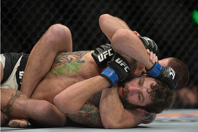 LAS VEGAS, NEVADA - DECEMBER 10:  (Back) Jim Miller attempts a submission on Michael Chiesa in their lightweight bout during the UFC Fight Night event at The Chelsea at the Cosmopolitan of Las Vegas on December 10, 2015 in Las Vegas, Nevada.  (Photo by Br