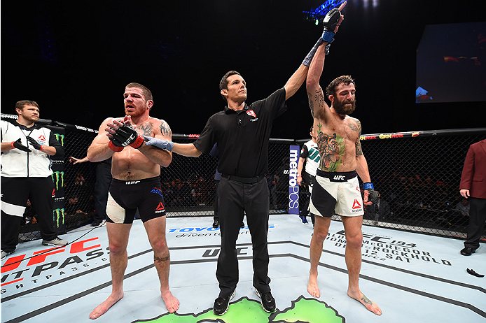 LAS VEGAS, NEVADA - DECEMBER 10:  (R) Michael Chiesa celebrates his win over Jim Miller in their lightweight bout during the UFC Fight Night event at The Chelsea at the Cosmopolitan of Las Vegas on December 10, 2015 in Las Vegas, Nevada.  (Photo by Jeff B
