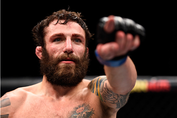 LAS VEGAS, NEVADA - DECEMBER 10:  Michael Chiesa celebrates his win over Jim Miller in their lightweight bout during the UFC Fight Night event at The Chelsea at the Cosmopolitan of Las Vegas on December 10, 2015 in Las Vegas, Nevada.  (Photo by Jeff Botta