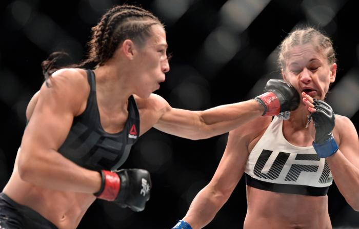 NEW YORK, NY - NOVEMBER 12:  (L-R) Joanna Jedrzejczyk of Poland punches Karolina Kowalkiewicz of Poland in their UFC women's strawweight championship fight during the UFC 205 event at Madison Square Garden on November 12, 2016 in New York City. (Photo by