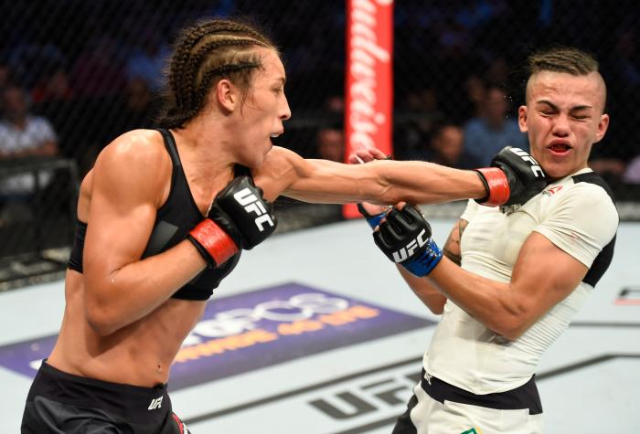 DALLAS, TX - MAY 13:  (L-R) Joanna Jedrzejczyk punches Jessica Andrade in their UFC women's strawweight championship fight during the UFC 211 event at the American Airlines Center on May 13, 2017 in Dallas, Texas. (Photo by Josh Hedges/Zuffa LLC/Zuffa LLC