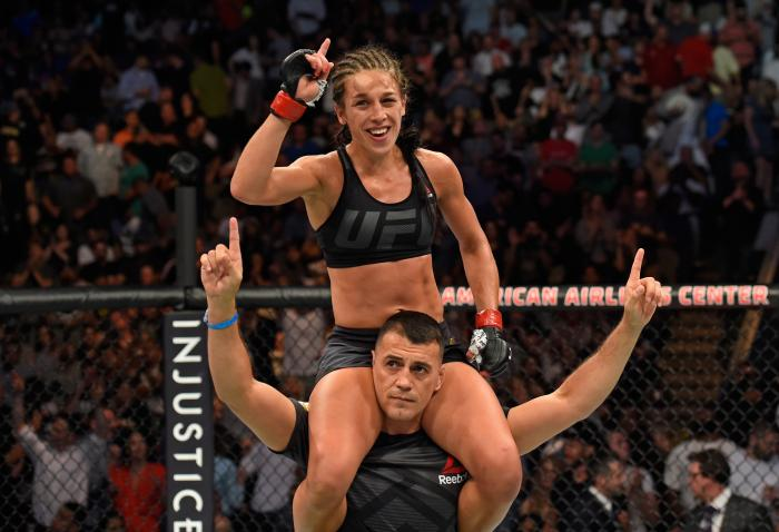 DALLAS, TX - MAY 13:  Joanna Jedrzejczyk raises her hands after  facing Jessica Andrade in their UFC women's strawweight championship fight during the UFC 211 event at the American Airlines Center on May 13, 2017 in Dallas, Texas. (Photo by Josh Hedges/Zu