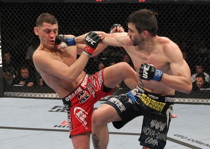 LAS VEGAS - FEBRUARY 04:  (R-L) Carlos Condit punches Nick Diaz during the UFC 143 event at Mandalay Bay Events Center on February 4, 2012 in Las Vegas, Nevada.  (Photo by Nick Laham/Zuffa LLC/Zuffa LLC via Getty Images) *** Local Caption *** Carlos Condi