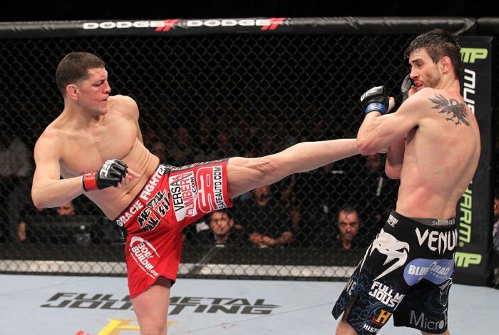 LAS VEGAS - FEBRUARY 04:  (L-R) Nick Diaz kicks Carlos Condit during the UFC 143 event at Mandalay Bay Events Center on February 4, 2012 in Las Vegas, Nevada.  (Photo by Nick Laham/Zuffa LLC/Zuffa LLC via Getty Images) *** Local Caption *** Nick Diaz; Car