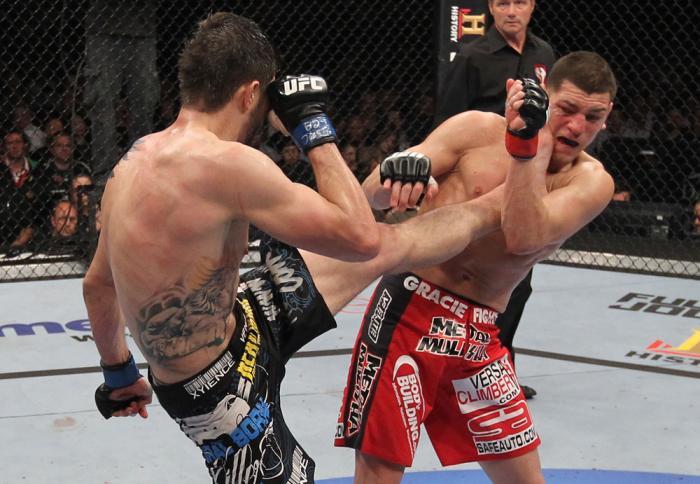 LAS VEGAS - FEBRUARY 04:  Carlos Condit (left) kicks Nick Diaz during the UFC 143 event at Mandalay Bay Events Center on February 4, 2012 in Las Vegas, Nevada.  (Photo by Nick Laham/Zuffa LLC/Zuffa LLC via Getty Images) *** Local Caption *** Carlos Condit