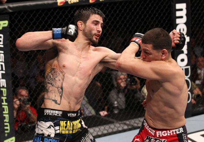 LAS VEGAS - FEBRUARY 04:  Carlos Condit (left) punches Nick Diaz during the UFC 143 event at Mandalay Bay Events Center on February 4, 2012 in Las Vegas, Nevada.  (Photo by Nick Laham/Zuffa LLC/Zuffa LLC via Getty Images) *** Local Caption *** Carlos Cond