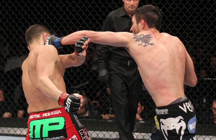 LAS VEGAS - FEBRUARY 04:  Carlos Condit (right) punches Nick Diaz during the UFC 143 event at Mandalay Bay Events Center on February 4, 2012 in Las Vegas, Nevada.  (Photo by Nick Laham/Zuffa LLC/Zuffa LLC via Getty Images) *** Local Caption *** Carlos Con