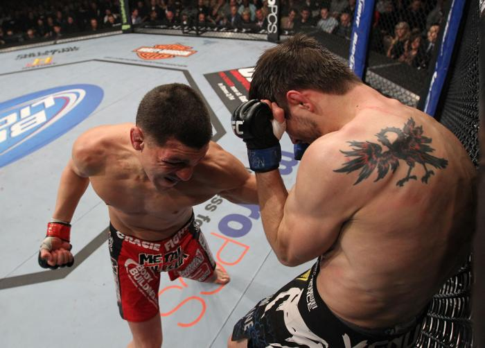 LAS VEGAS - FEBRUARY 04:  Nick Diaz (left) punches Carlos Condit during the UFC 143 event at Mandalay Bay Events Center on February 4, 2012 in Las Vegas, Nevada.  (Photo by Nick Laham/Zuffa LLC/Zuffa LLC via Getty Images) *** Local Caption *** Nick Diaz;