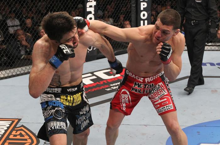 LAS VEGAS - FEBRUARY 04:  (R-L) Nick Diaz punches Carlos Condit during the UFC 143 event at Mandalay Bay Events Center on February 4, 2012 in Las Vegas, Nevada.  (Photo by Nick Laham/Zuffa LLC/Zuffa LLC via Getty Images) *** Local Caption *** Carlos Condi