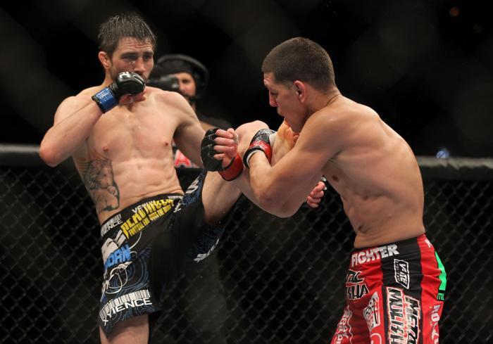 LAS VEGAS - FEBRUARY 04:  Carlos Condit (left) kicks Nick Diaz during the UFC 143 event at Mandalay Bay Events Center on February 4, 2012 in Las Vegas, Nevada.  (Photo by Josh Hedges/Zuffa LLC/Zuffa LLC via Getty Images) *** Local Caption *** Carlos Condi
