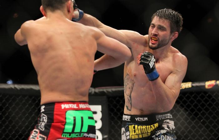 LAS VEGAS - FEBRUARY 04:  Carlos Condit (right) punches Nick Diaz during the UFC 143 event at Mandalay Bay Events Center on February 4, 2012 in Las Vegas, Nevada.  (Photo by Josh Hedges/Zuffa LLC/Zuffa LLC via Getty Images) *** Local Caption *** Carlos Co