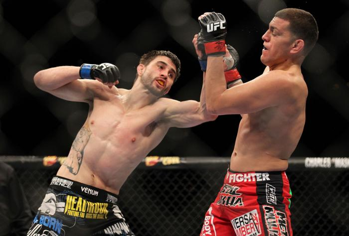 LAS VEGAS - FEBRUARY 04:  Carlos Condit (left) punches Nick Diaz during the UFC 143 event at Mandalay Bay Events Center on February 4, 2012 in Las Vegas, Nevada.  (Photo by Josh Hedges/Zuffa LLC/Zuffa LLC via Getty Images) *** Local Caption *** Carlos Con