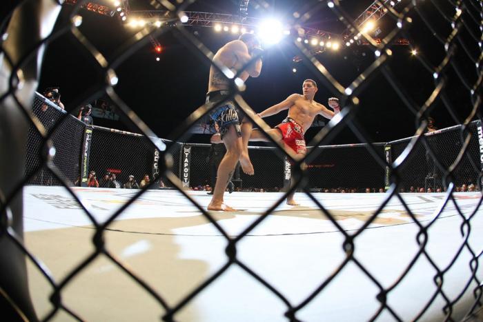 LAS VEGAS - FEBRUARY 04:  (R-L) Nick Diaz kicks Carlos Condit during the UFC 143 event at Mandalay Bay Events Center on February 4, 2012 in Las Vegas, Nevada.  (Photo by Nick Laham/Zuffa LLC/Zuffa LLC via Getty Images) *** Local Caption *** Nick Diaz; Car