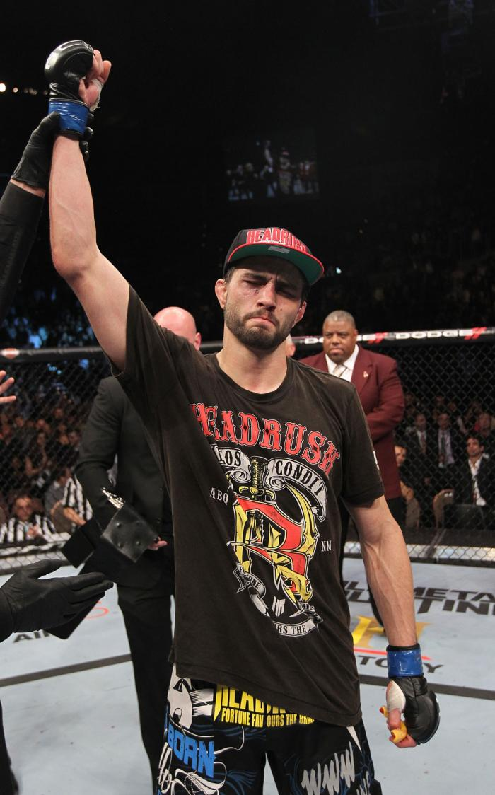 LAS VEGAS - FEBRUARY 04:  Carlos Condit is declared the winner in his fight with Nick Diaz during the UFC 143 event at Mandalay Bay Events Center on February 4, 2012 in Las Vegas, Nevada.  (Photo by Nick Laham/Zuffa LLC/Zuffa LLC via Getty Images) *** Loc