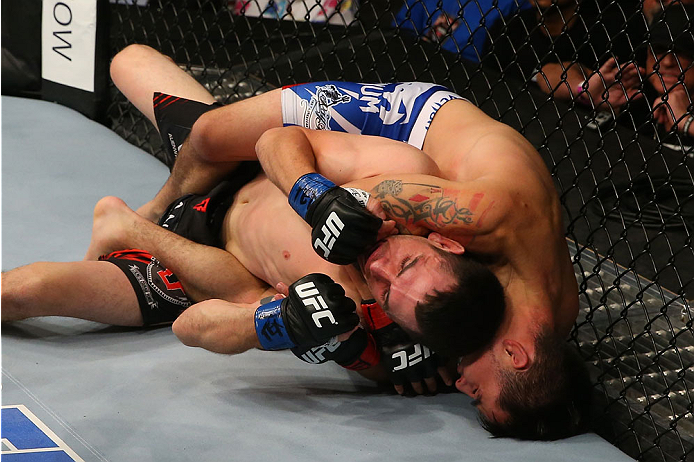 SAN ANTONIO, TX - JUNE 28:  Ray Borg (top) attempts to submit Shane Howell in their flyweight bout at the AT&T Center on June 28, 2014 in San Antonio, Texas. (Photo by Ed Mulholland/Zuffa LLC/Zuffa LLC via Getty Images)