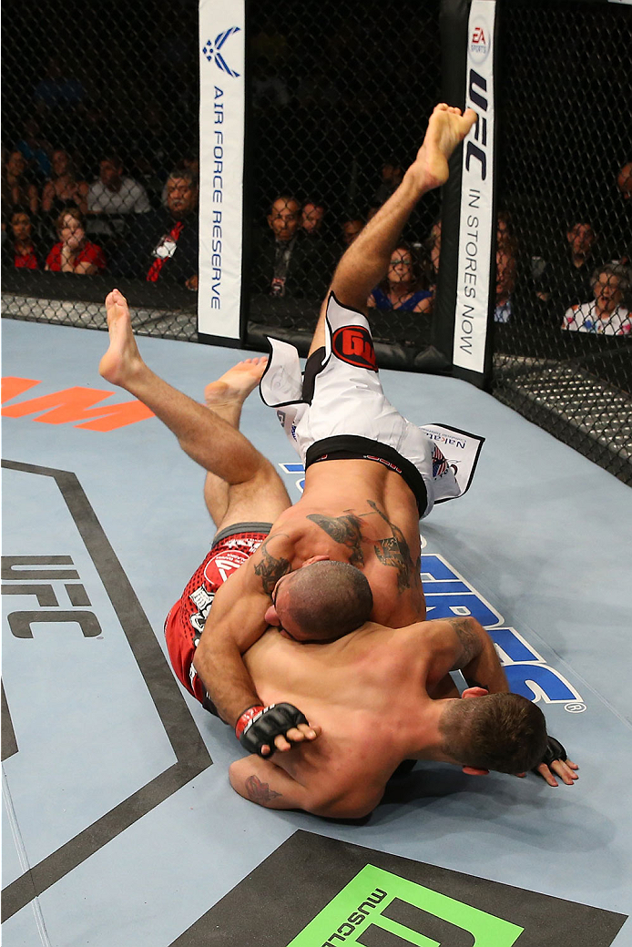 SAN ANTONIO, TX - JUNE 28:  Marcelo Guimaraes (top) slams Andy Enz in their middleweight bout at the AT&T Center on June 28, 2014 in San Antonio, Texas. (Photo by Ed Mulholland/Zuffa LLC/Zuffa LLC via Getty Images)