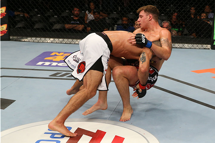 SAN ANTONIO, TX - JUNE 28:  Marcelo Guimaraes (left) takes down Andy Enz in their middleweight bout at the AT&T Center on June 28, 2014 in San Antonio, Texas. (Photo by Ed Mulholland/Zuffa LLC/Zuffa LLC via Getty Images)