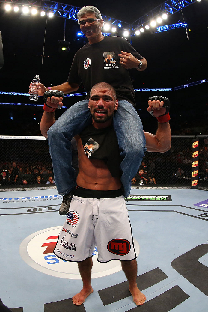SAN ANTONIO, TX - JUNE 28:  Marcelo Guimaraes (bottom) reacts after his victory over Andy Enz in their middleweight bout at the AT&T Center on June 28, 2014 in San Antonio, Texas. (Photo by Ed Mulholland/Zuffa LLC/Zuffa LLC via Getty Images)