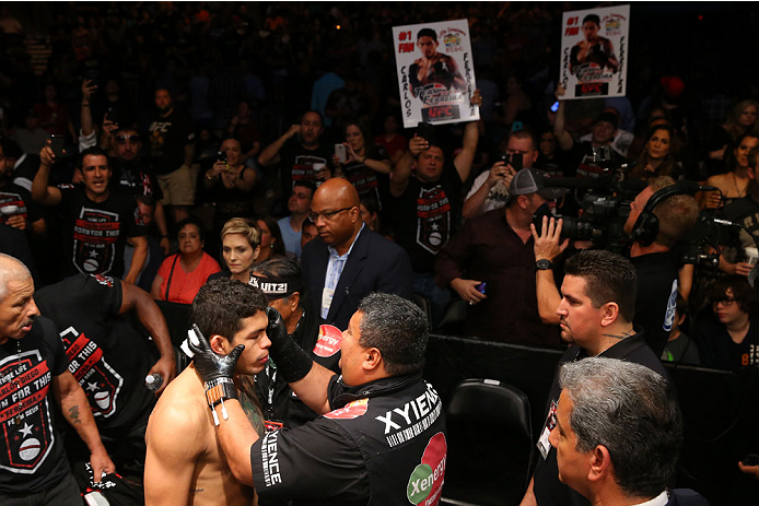 SAN ANTONIO, TX - JUNE 28:  Carlos Diego Ferreira (bottom) gets prepared to enter the Octagon to face Colton Smith in their lightweight bout at the AT&T Center on June 28, 2014 in San Antonio, Texas. (Photo by Ed Mulholland/Zuffa LLC/Zuffa LLC via Getty I