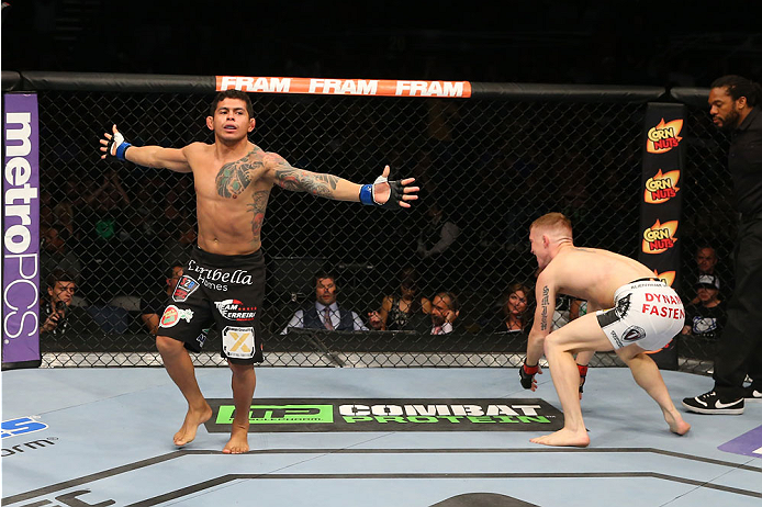SAN ANTONIO, TX - JUNE 28:  Carlos Diego Ferreira (left) reacts to his submission victory over Colton Smith (white shorts) in their lightweight bout at the AT&T Center on June 28, 2014 in San Antonio, Texas. (Photo by Ed Mulholland/Zuffa LLC/Zuffa LLC via