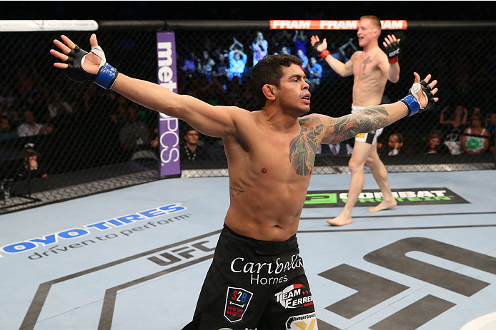 SAN ANTONIO, TX - JUNE 28:  Carlos Diego Ferreira reacts to his victory over Colton Smith in their lightweight bout at the AT&T Center on June 28, 2014 in San Antonio, Texas. (Photo by Ed Mulholland/Zuffa LLC/Zuffa LLC via Getty Images)