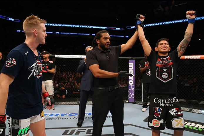 SAN ANTONIO, TX - JUNE 28:  Carlos Diego Ferreira (right) reacts to his victory over Colton Smith (left) in their lightweight bout at the AT&T Center on June 28, 2014 in San Antonio, Texas. (Photo by Ed Mulholland/Zuffa LLC/Zuffa LLC via Getty Images)