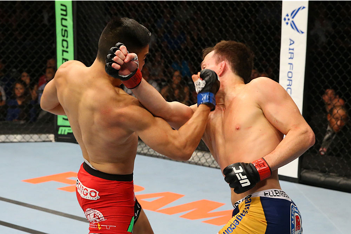 SAN ANTONIO, TX - JUNE 28:  (L-R) James Moontasri punches Joe Ellenberger in their lightweight bout at the AT&T Center on June 28, 2014 in San Antonio, Texas. (Photo by Ed Mulholland/Zuffa LLC/Zuffa LLC via Getty Images)