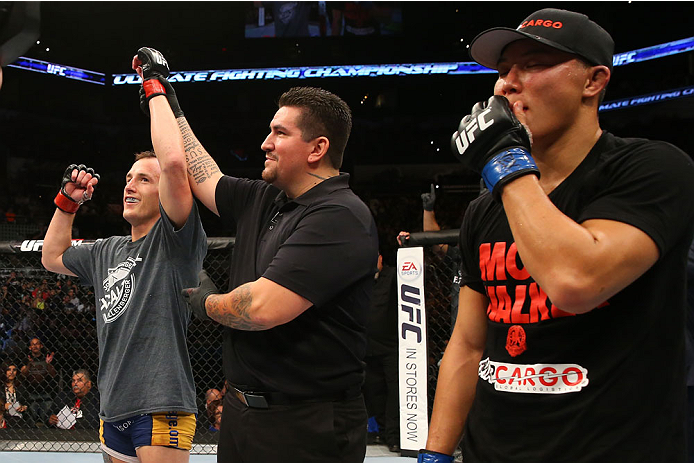 SAN ANTONIO, TX - JUNE 28:  Joe Ellenberger (left) reacts to his victory over James Moontasri (right) in their lightweight bout at the AT&T Center on June 28, 2014 in San Antonio, Texas. (Photo by Ed Mulholland/Zuffa LLC/Zuffa LLC via Getty Images)