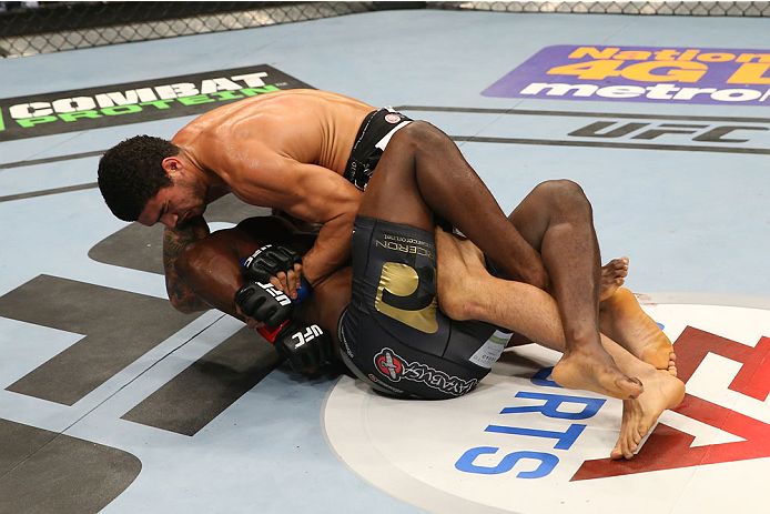 SAN ANTONIO, TX - JUNE 28:  Antonio Braga Neto (top) attempts to submit Clint Hester in their middleweight bout at the AT&T Center on June 28, 2014 in San Antonio, Texas. (Photo by Ed Mulholland/Zuffa LLC/Zuffa LLC via Getty Images)