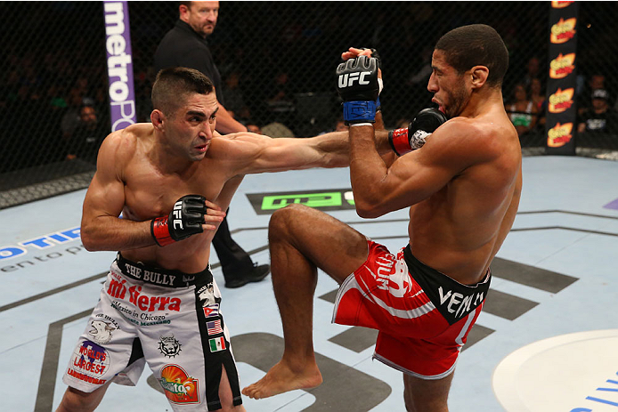 SAN ANTONIO, TX - JUNE 28:  (L-R) Ricardo Lamas punches Hacran Dias in their featherweight bout at the AT&T Center on June 28, 2014 in San Antonio, Texas. (Photo by Ed Mulholland/Zuffa LLC/Zuffa LLC via Getty Images)