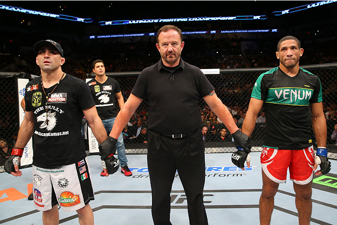 SAN ANTONIO, TX - JUNE 28:  Ricardo Lamas (left) and Hacran Dias (right) await the official decision in their featherweight bout at the AT&T Center on June 28, 2014 in San Antonio, Texas. (Photo by Ed Mulholland/Zuffa LLC/Zuffa LLC via Getty Images)