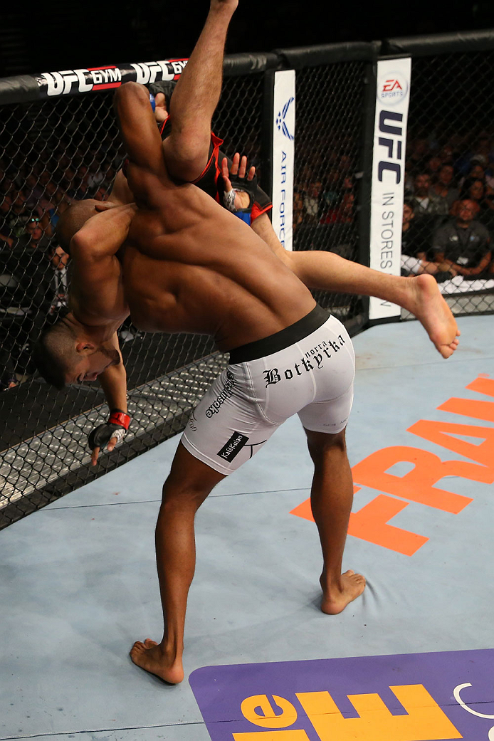 SAN ANTONIO, TX - JUNE 28:  Nico Musoke (white shorts) slams Kelvin Gastelum in their welterweight bout at the AT&T Center on June 28, 2014 in San Antonio, Texas. (Photo by Ed Mulholland/Zuffa LLC/Zuffa LLC via Getty Images)