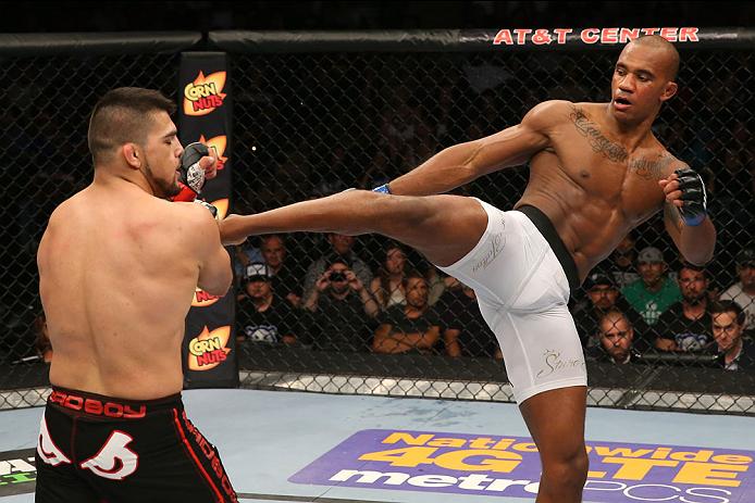 SAN ANTONIO, TX - JUNE 28:  (R-L) Nico Musoke kicks Kelvin Gastelum in their welterweight bout at the AT&T Center on June 28, 2014 in San Antonio, Texas. (Photo by Ed Mulholland/Zuffa LLC/Zuffa LLC via Getty Images)